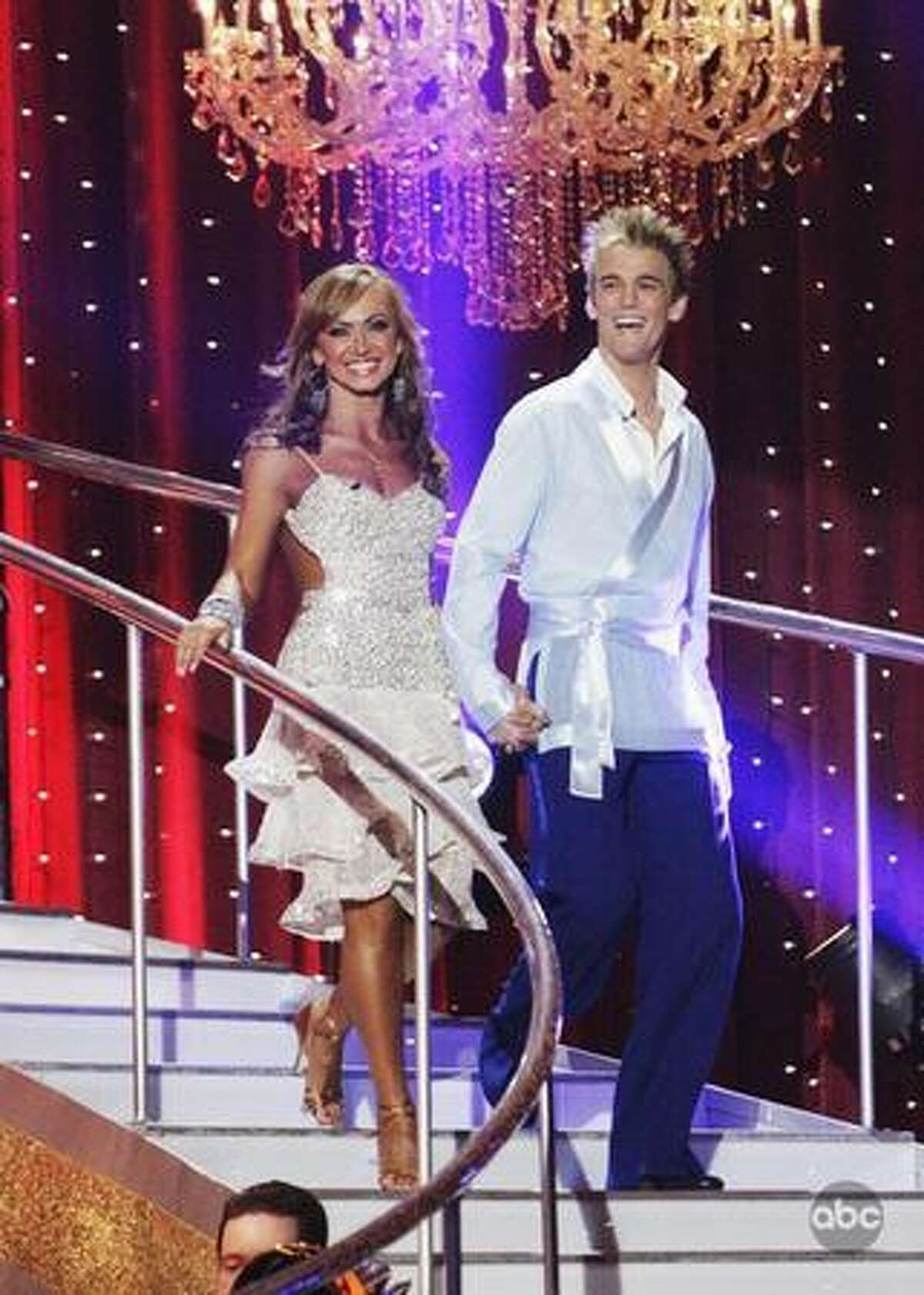 Karina Smirnoff and singer Aaron Carter enter the stage on Monday night's episode of