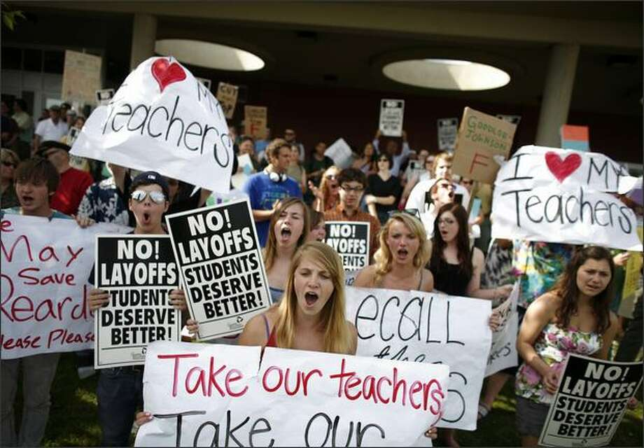 Protesters chant and hold signs directed at Superintendent Maria Goodloe-Johnson and school board members during a protest in recent reduction in force (RIF) layoffs within Seattle Public Schools at the John Stanford Center for Educational Excellence on June, 3, 2009 in Seattle. (Joshua Trujillo, Seattlepi.com) Photo: Joshua Trujillo/seattlepi.com