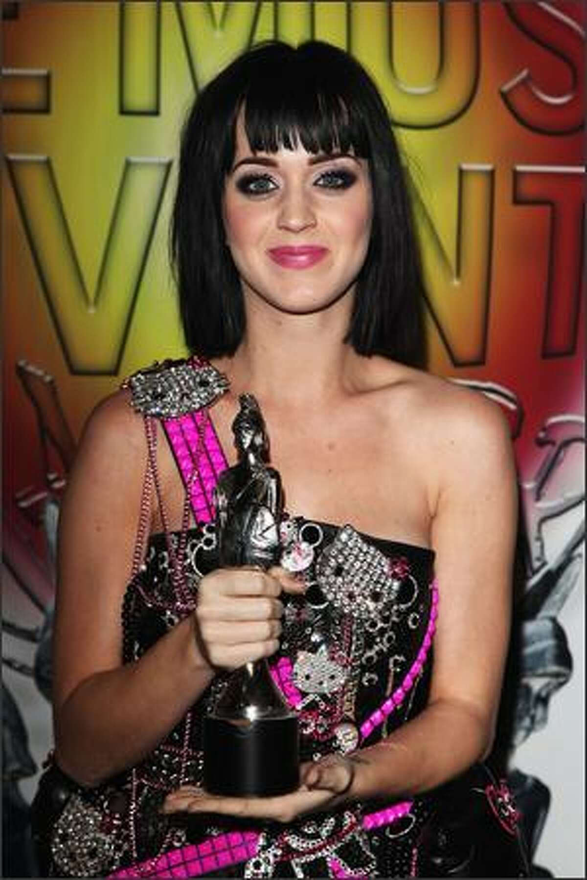Katy Perry poses with the award for Best International Female Solo Artist backstage during the Brit Awards 2009 at Earls Court in London, England.
