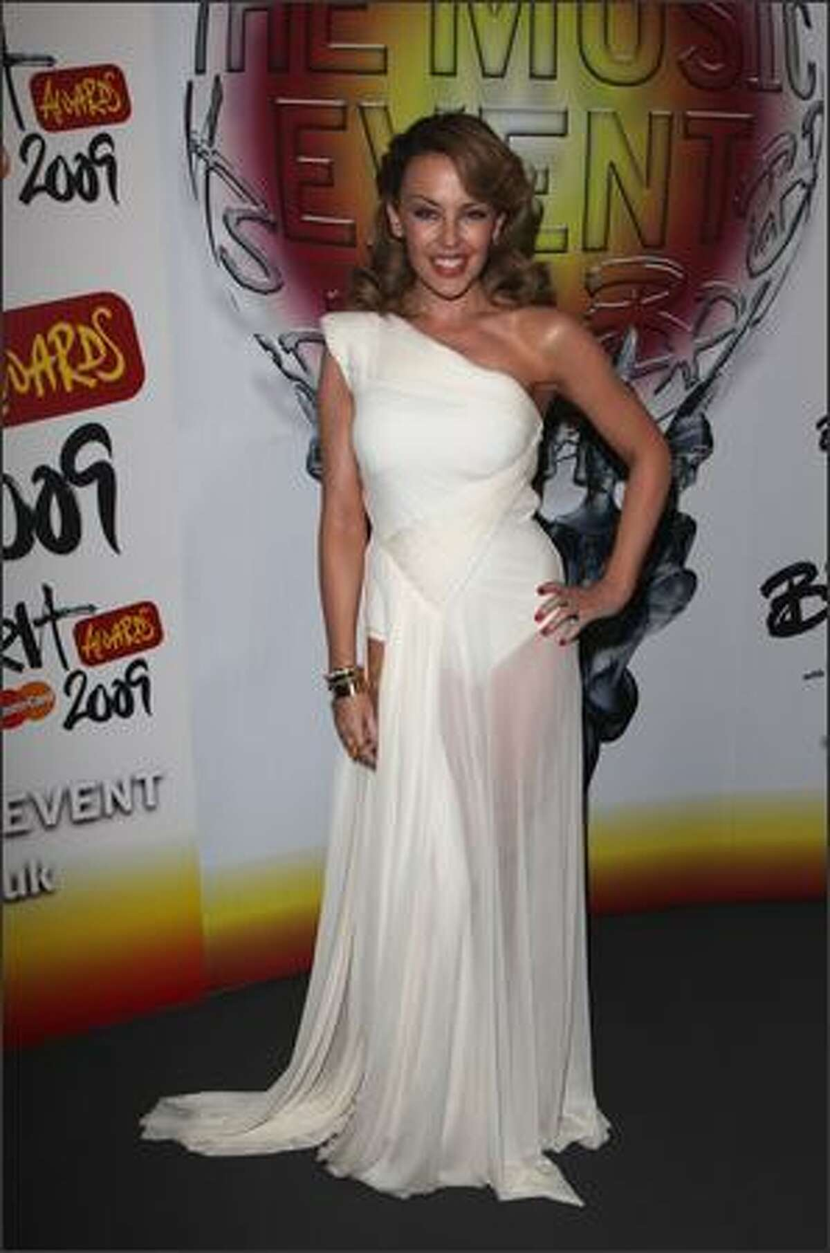 Singer and host Kylie Minogue poses backstage during the Brit Awards 2009 at Earls Court in London, England.