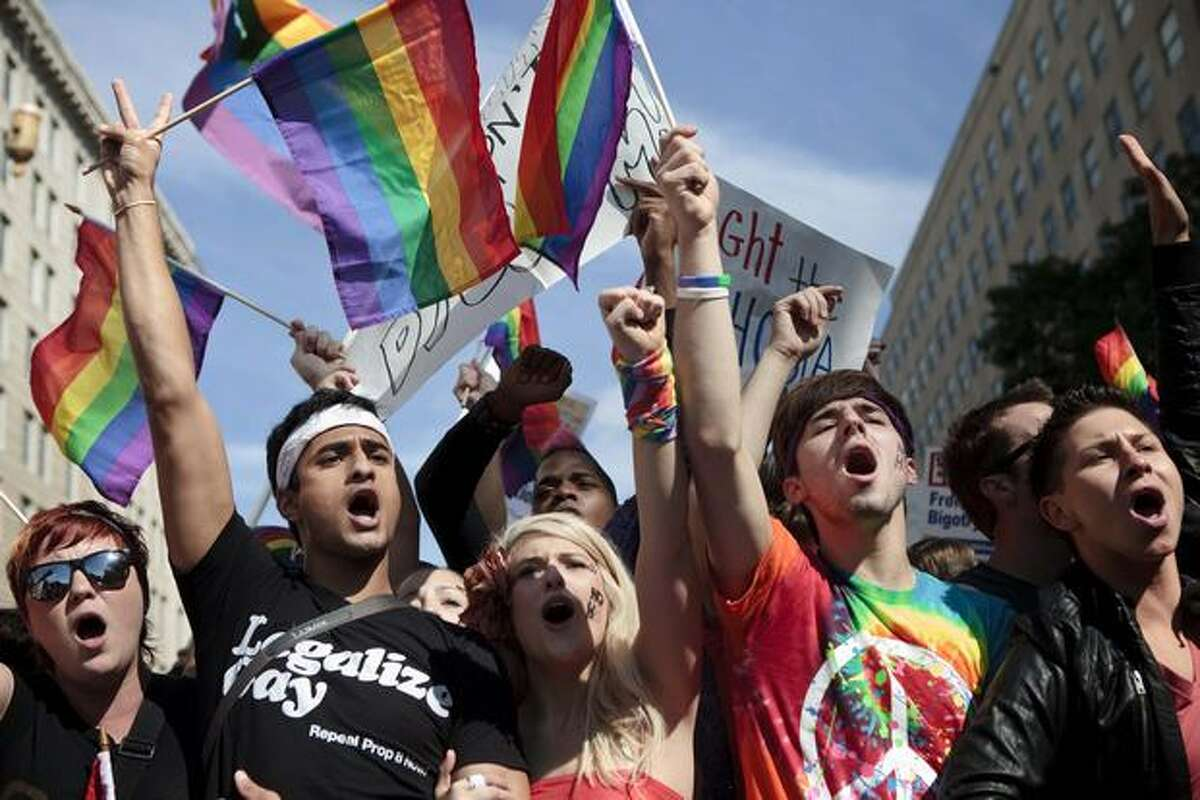 Activists yell during a protest Sunday in Washington, DC. Activists gathered in DC to push President Barack Obama's administration and the U.S. Congress to live up to promises to the lesbian, gay, bisexual and transgender community to advance civil rights.