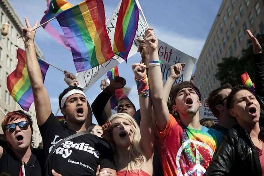 Activists yell during a protest Sunday in Washington, DC. Activists gathered in DC to push President Barack Obama's administration and the U.S. Congress to live up to promises to the lesbian, gay, bisexual and transgender community to advance civil rights. Photo: Getty Images