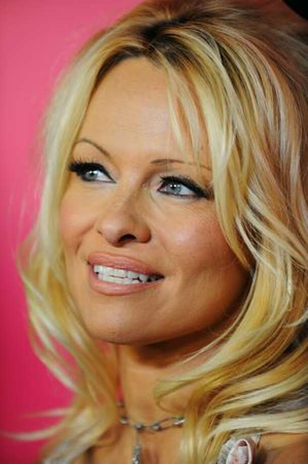 Actress Pamela Anderson arrives for the 6th Annual Hollywood Style Awards at Armand Hammer Museum in Los Angeles, California. Photo: Getty Images