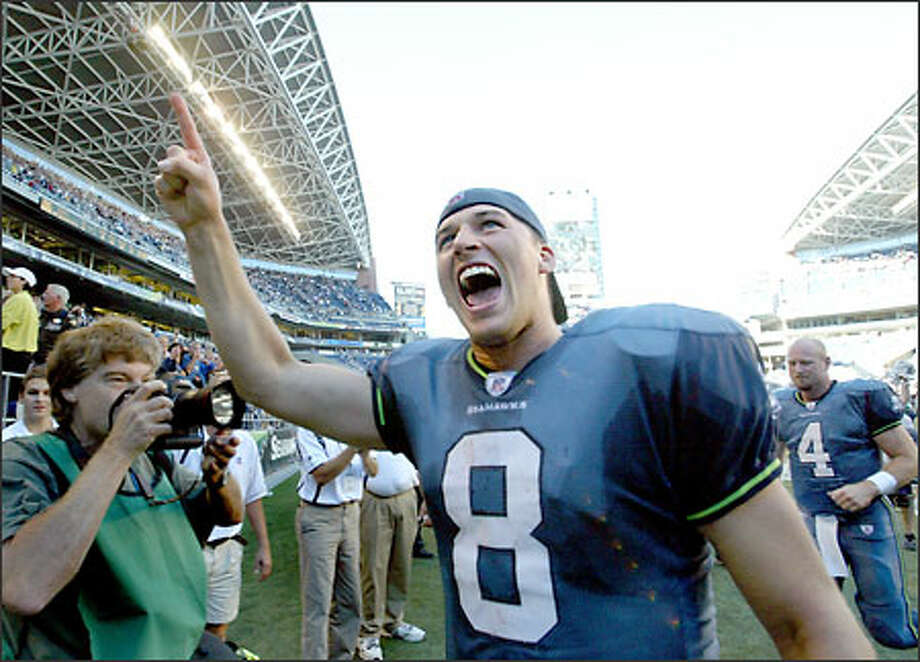 Quarterback Matt Hasselbeck leaves the field moments after hitting Koren Robinson for the winning touchdown from three yards out with a minute to play. Photo: Scott Eklund, Seattle Post-Intelligencer