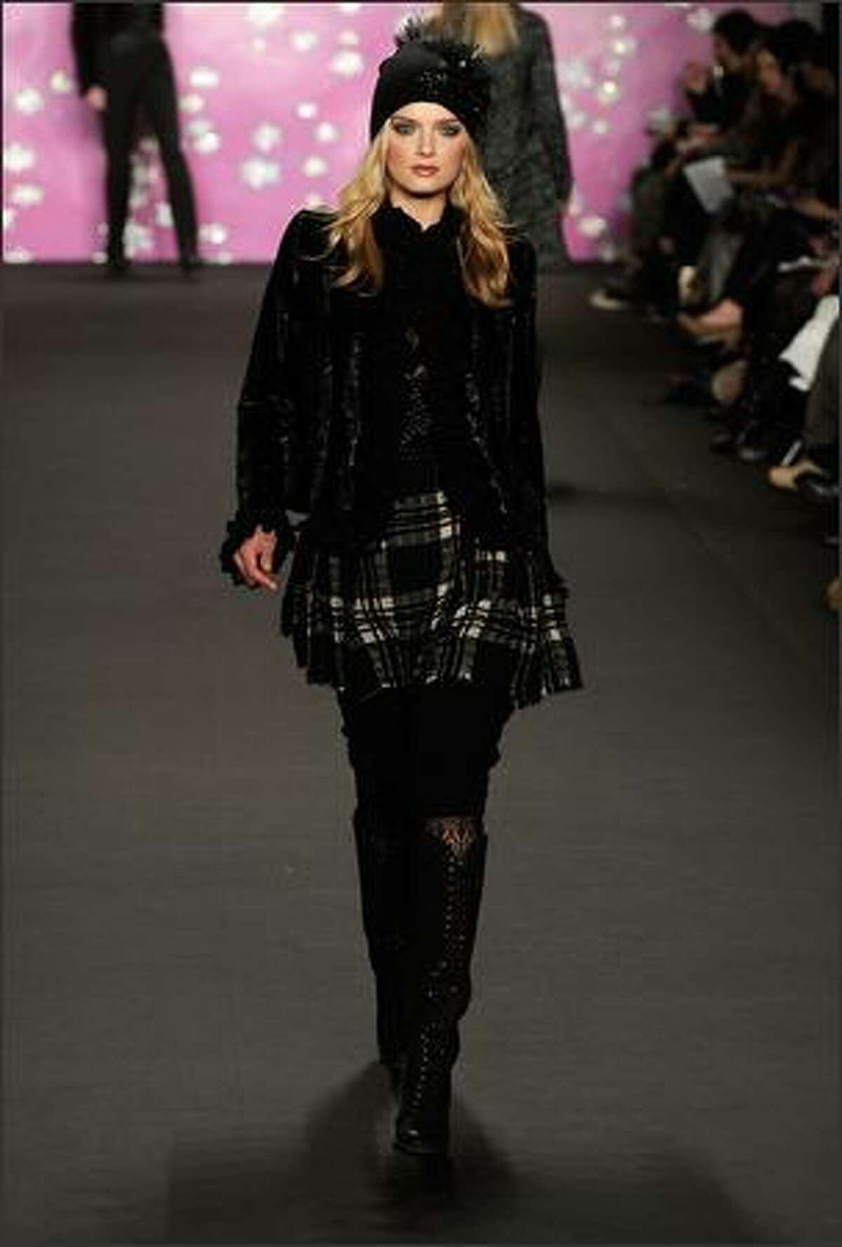 A model walks the runway at the Anna Sui Fall 2009 fashion show during Mercedes-Benz Fashion Week in the Tent at New York's Bryant Park on Wednesday, Feb. 18, 2009.