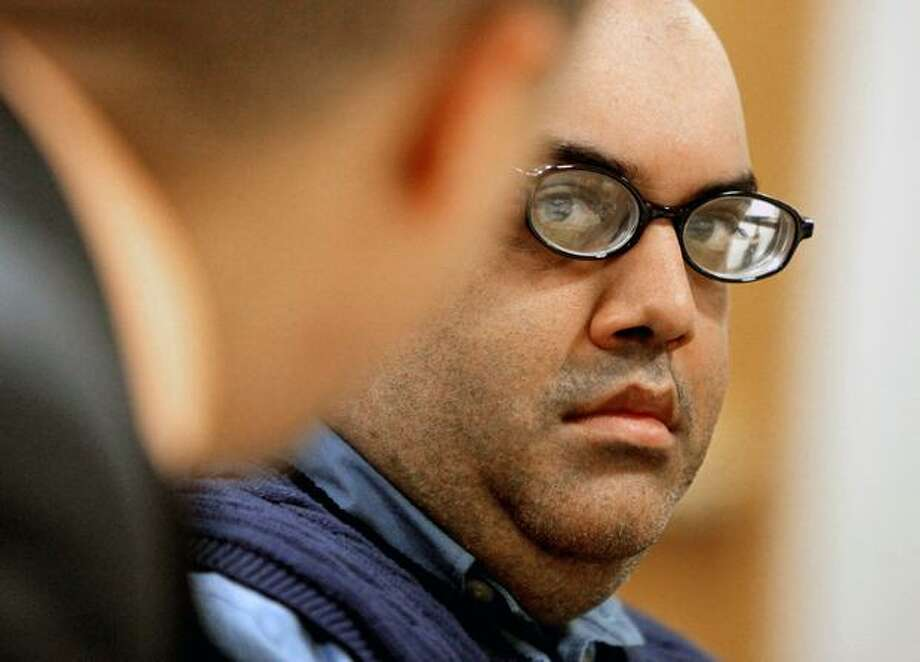 Naveed Haq sits in court during a hearing on whether or not taped phone calls from jail can be used against him. Photo: Clifford DesPeaux/seattlepi.com