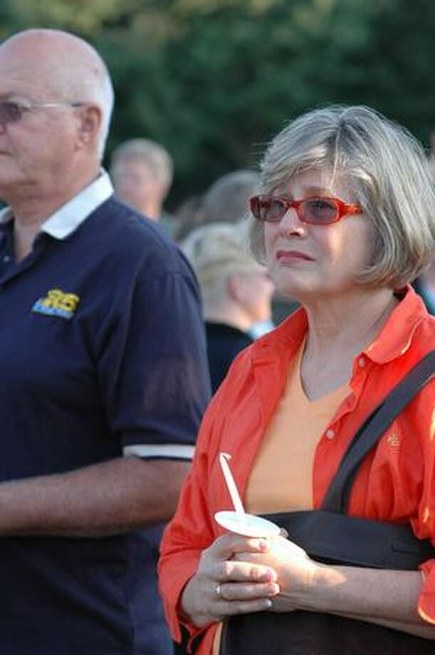 "Elizabeth Graham, right, and Bob Cronn watch the start of a candle light vigil for the victim of a stabbing early last week at the South Park Community Center in south Seattle Thursday July 23, 2009. Said Graham, ""I am here because this is a tragedy."" Photo by Daniel Berman/SeattlePI.com Photo: Daniel Berman, Seattlepi.com"