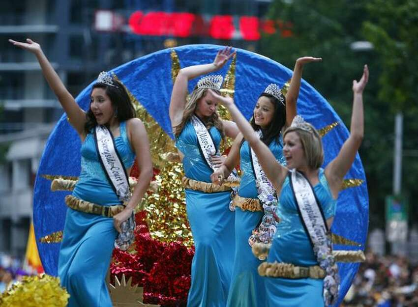 Miss Sunnyside and her princesses ride on a float during the Seafair Torchlight parade on Saturday July 25, 2009 along 4th Avenue in Seattle.