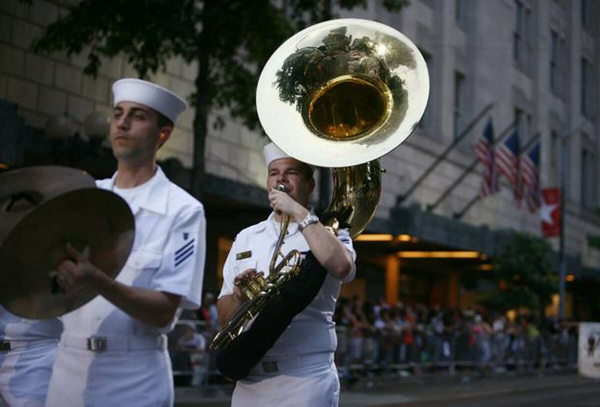A U.S. Navy marching band performs during the Seafair Torchlight parade on Saturday July 25, 2009 along 4th Avenue in Seattle.