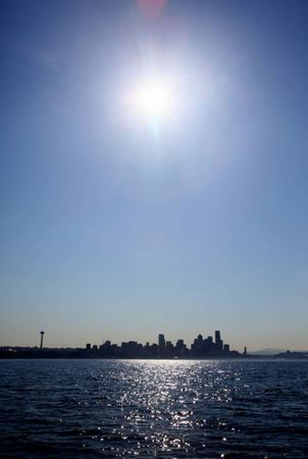 The sun beats down on Seattle on Monday as seen from Elliott Bay.