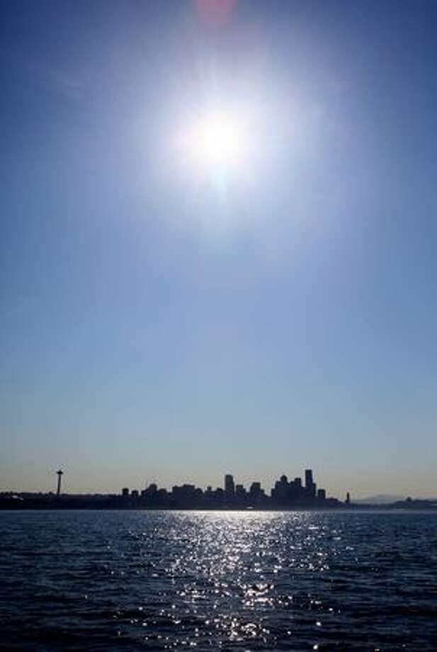 The sun beats down on Seattle on Monday as seen from Elliott Bay. Photo: Joshua Trujillo, Seattlepi.com