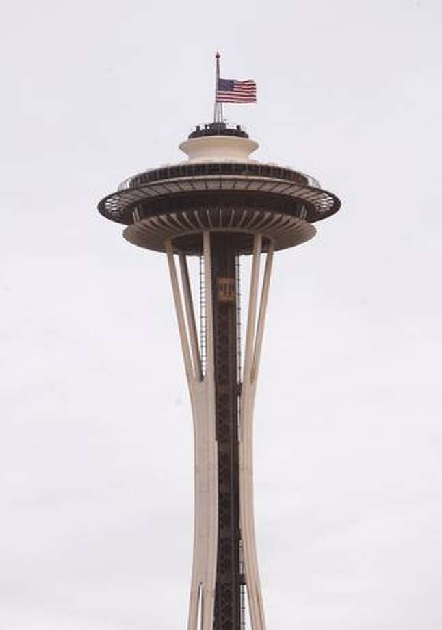 The flag atop the Space Needle flew at half-mast Tuesday. Seattle Mayor Greg Nickels ordered city flags lowered to half-staff until after Brenton's funeral. A public memorial is scheduled for 1 p.m. Friday at KeyArena. Photo: Casey McNerthney, Seattlepi.com