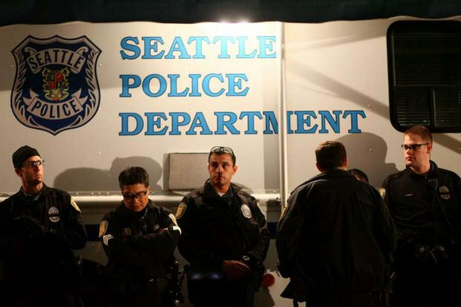 Seattle Police officers gather during the vigil. Photo: Joshua Trujillo, Seattlepi.com
