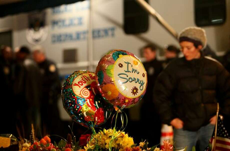 A growing memorial is shown at East Yesler Way and 29th Avenue. Photo: Joshua Trujillo, Seattlepi.com