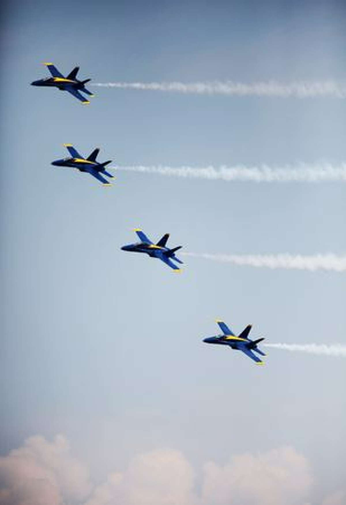 The U.S. Navy Blue Angels demonstration team fly their Boeing F/A-18 Hornets over Lake Washington during a practice on Thursday in Seattle
