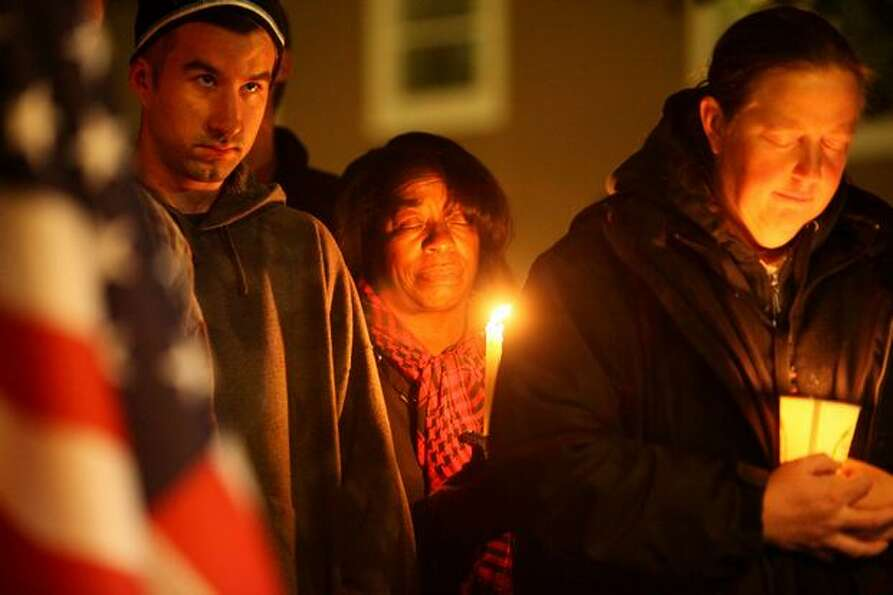 People participate in prayer during Monday night's vigil.
