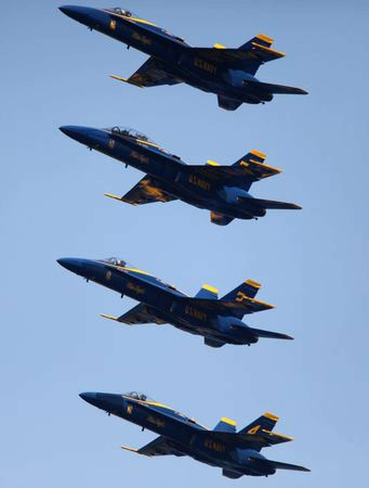 The U.S. Navy Blue Angels demonstration team fly their Boeing F/A-18 Hornets over Lake Washington during a practice on Thursday in Seattle.
