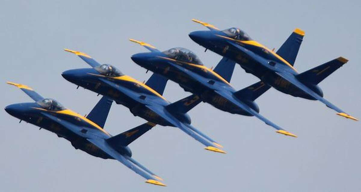 The U.S. Navy Blue Angels demonstration team fly their Boeing F/A-18 Hornets over Lake Washington during a practice on Thursday