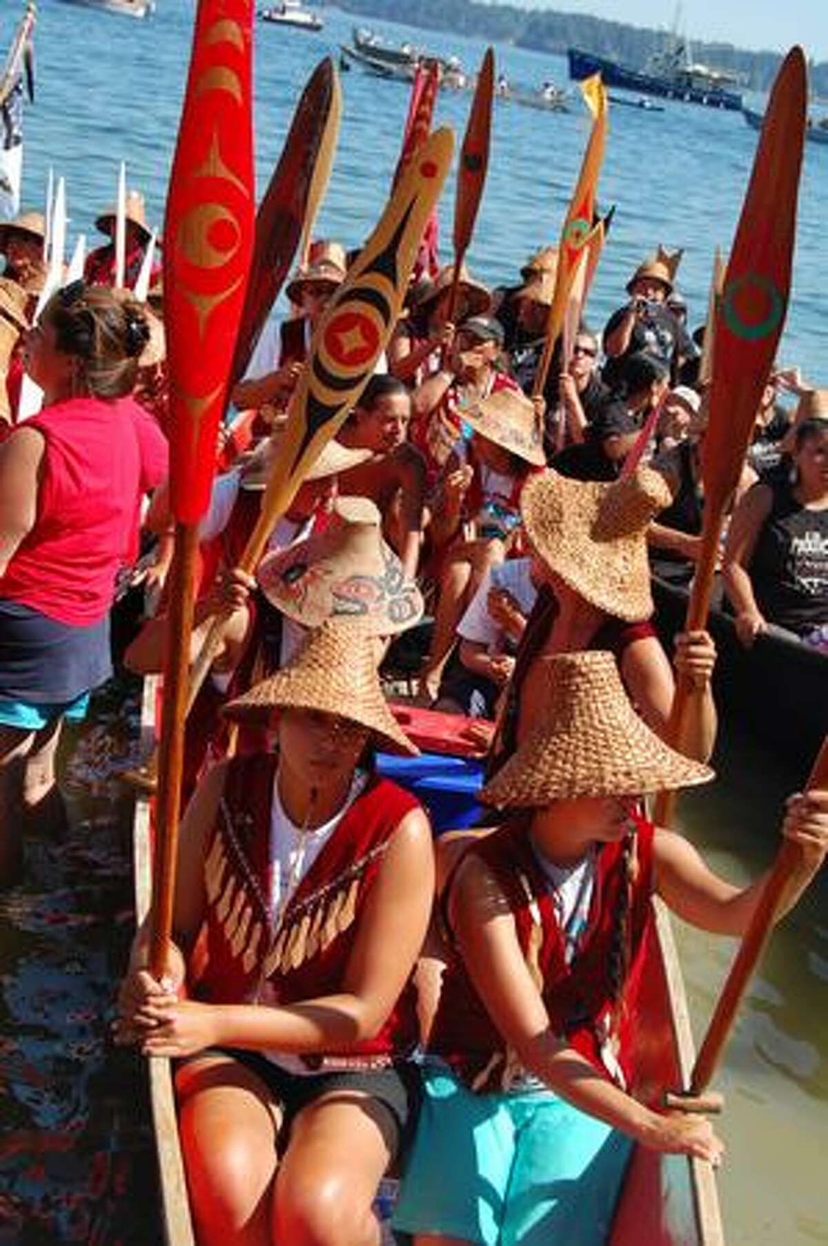 Paddlers arrive Monday afternoon at Suquamish. Native American canoes from several Northwest tribes took part in the landing, the culmination of an days-long event known as