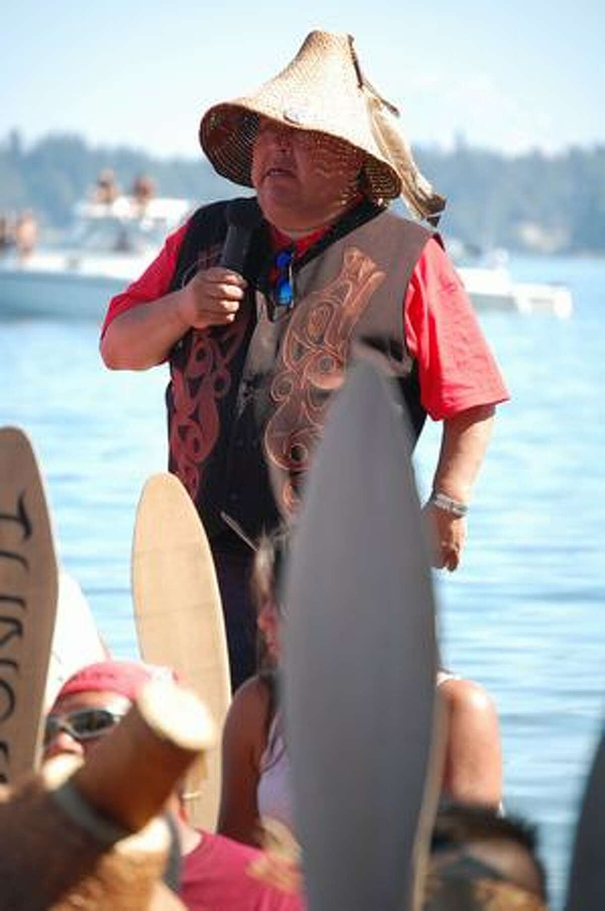 Following on ancient tradition, a canoe captain requests permission to come ashore from Suquamish leaders. Native American canoes from several Northwest tribes took part in the landing, the culmination of an days-long event known as