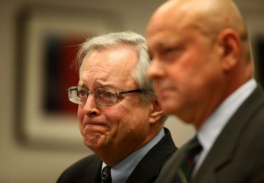 Former King County Assessor Scott Noble reacts as his attorney John Wolfe, right, explains how the former public official destroyed his career during a sentencing hearing in front of King County Judge Michael J. Fox on Friday at the King County Courthouse in Seattle. Noble was convicted one count of vehicular assault in a drunken driving case and was sentenced to eight months of work release, which will allow Noble to pursue employment. He resigned from his elected position Thursday. Photo: Joshua Trujillo/seattlepi.com