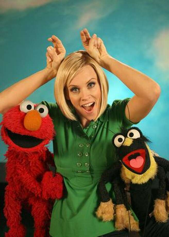 "Take a look at celebrities on ""Sesame Street"" over the years:Jenny McCarthy defines the word ""insect"" with Elmo and, um, an insect. Photo: PBS"