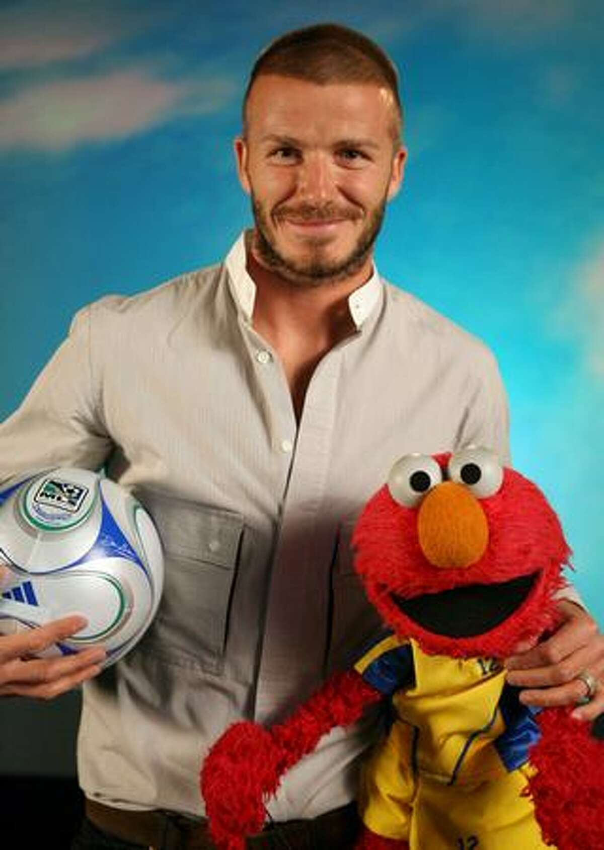 Soccer sensation David Beckham with Elmo.