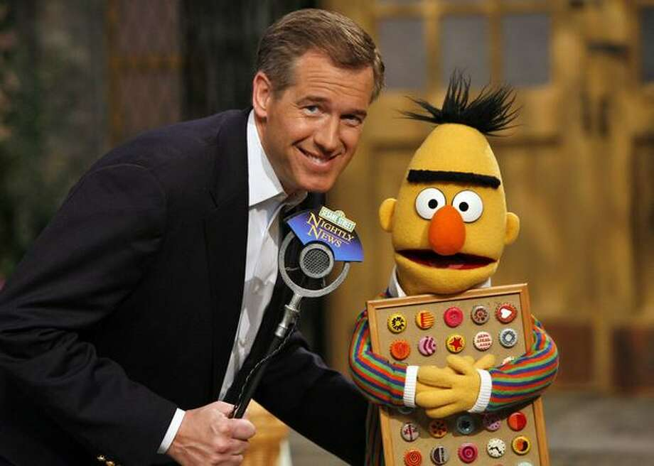"NBC anchor Brian Williams reports on the ""Sesame Street Nightly News Update"" in 2008. Photo: PBS"