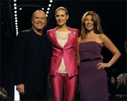 Supermodel and show host Heidi Klum (center) and judges Michael Kors and Nina Garcia pose before the season finale show. Photo: Getty Images