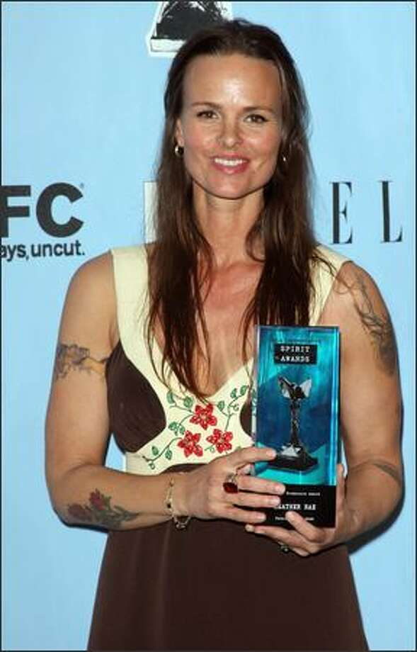 "Producer Heather Rae poses in the press room with the Producers Award for ""Frozen River."" Photo: Getty Images"