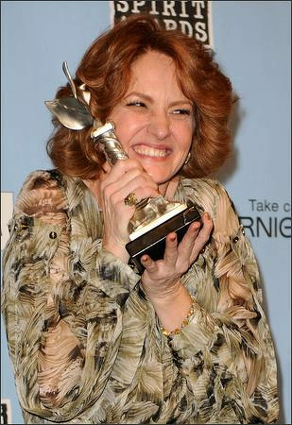 Actress Melissa Leo holds her award for Best Actress for
