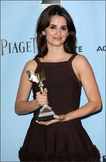 Actress Penelope Cruz poses in the press room with the Best Supporting Female award for