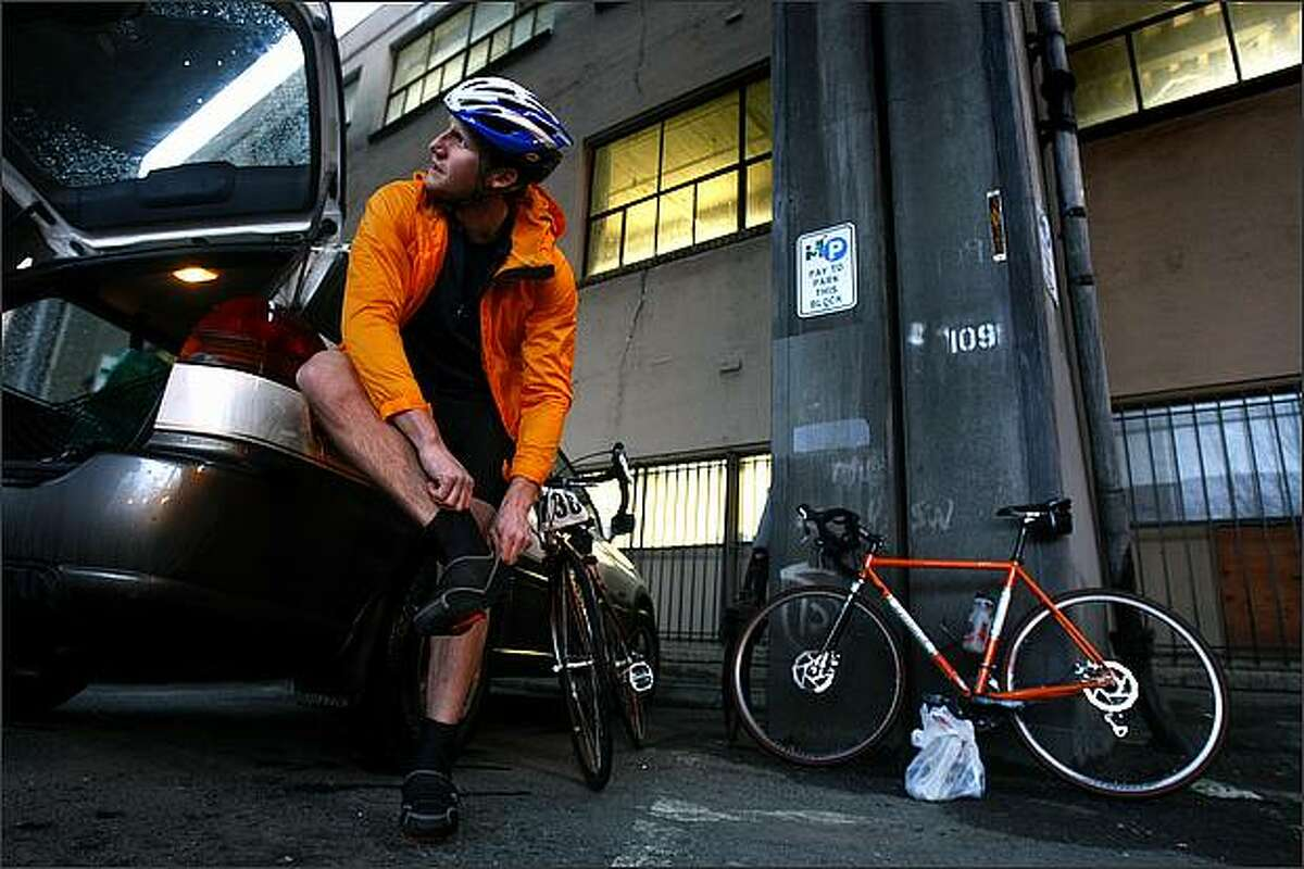 Chuck Sloan of Seattle gets his footwear in order underneath the Alaskan Way Viaduct before boarding the ferry for Bainbridge Island to take part in the Chilly Hilly bicycle ride.