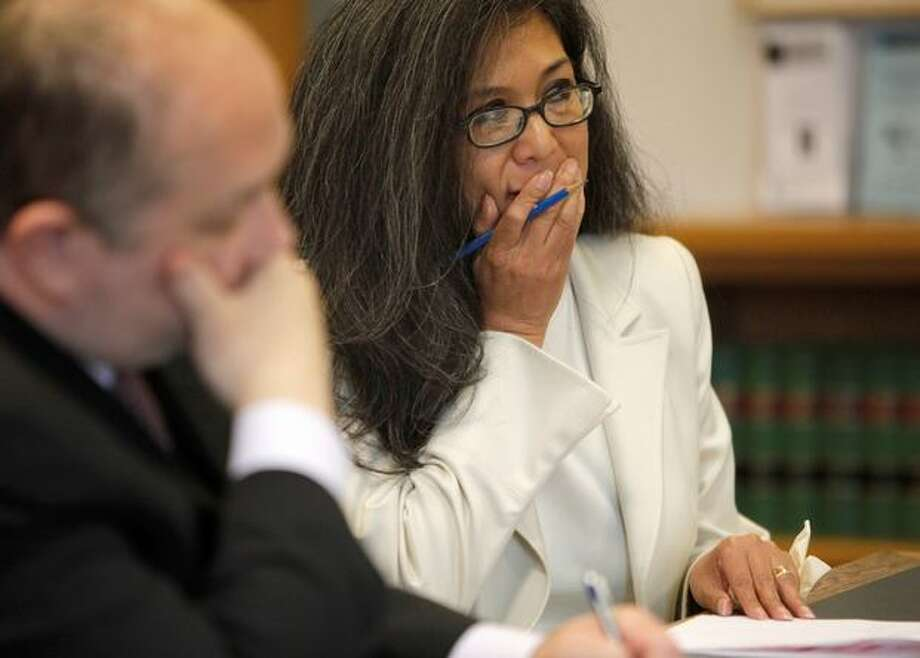 Cecilia Cordova, attorney for a group of City of Seattle employees, reacts after Judge John Erlick blocked the release of names of employees who recieved e-mail notifications about an LGBT group during a hearing at the King County Courthouse on Thursday. Photo: Clifford DesPeaux/seattlepi.com