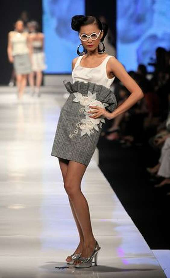 A model showcases designs on the runway by Handy Hartono as part of APPMI Show 6 on day two of Jakarta Fashion Week 2009 at the Fashion Tent, Pacific Place on Sunday in Jakarta, Indonesia. Photo: Getty Images