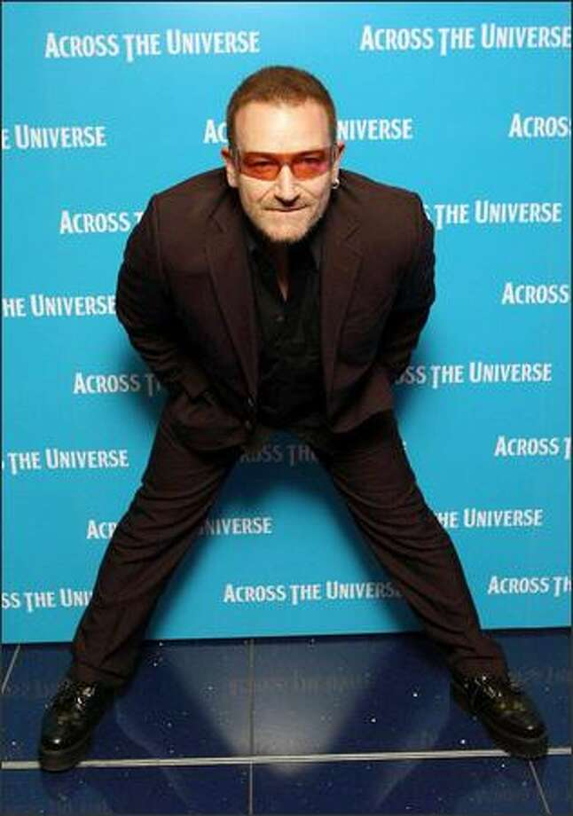U2 singer Bono arrives for the premiere of the film Across The Universe at the Apollo cinema, in cental London on Wednesday Sept. 26 2007. (Associated Press)