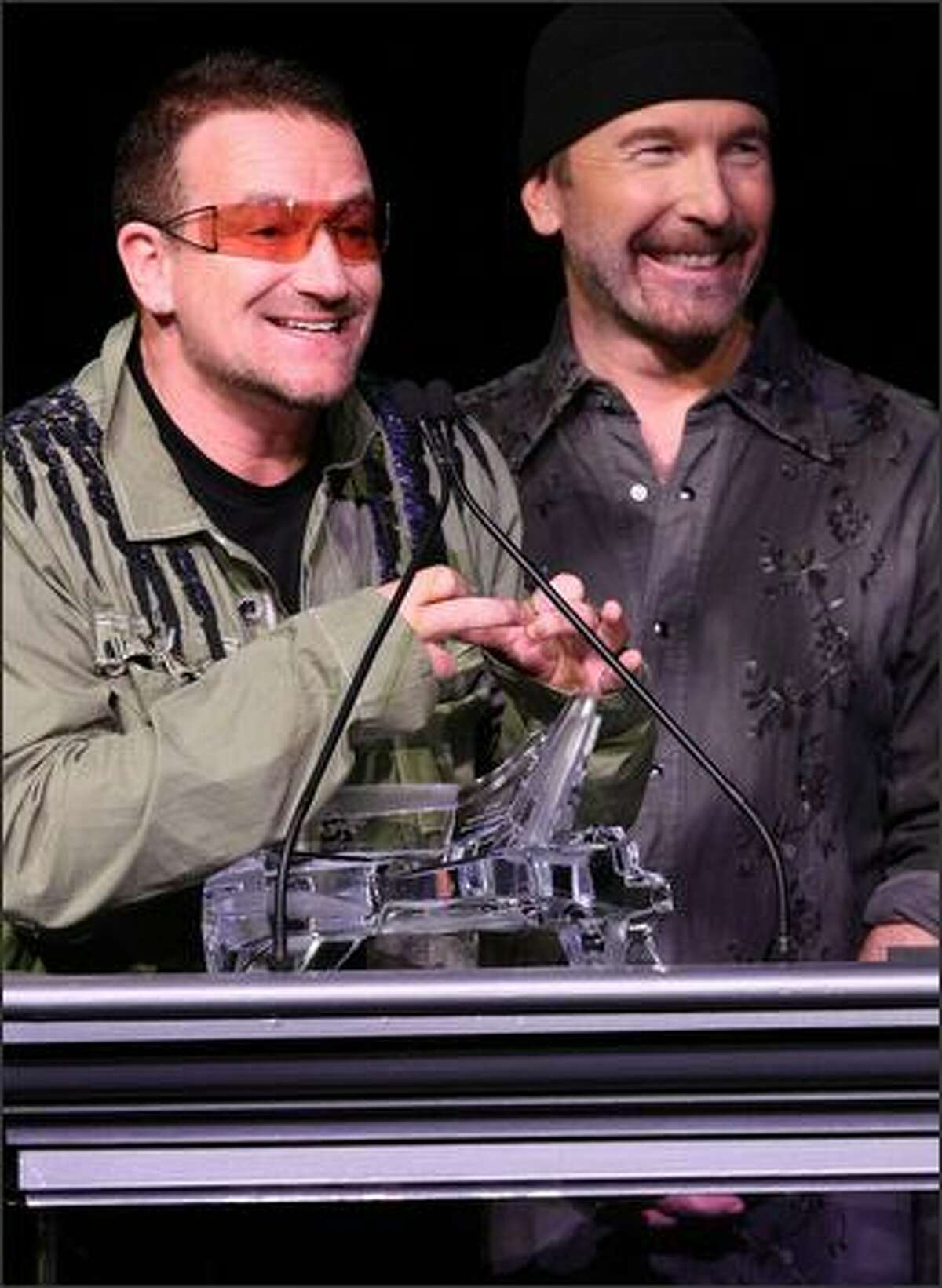 Musicians Bono and The Edge of U2 onstage during the Thelonious Monk Institute of Jazz honoring B.B. King event held at the Kodak Theatre on October 26, 2008, in Los Angeles, California. (Getty)