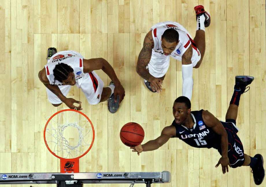 ANAHEIM, CA - MARCH 24:  Kemba Walker #15 of the Connecticut Huskies goes to the hoop against Kawhi Leonard #15 and Malcolm Thomas #4 of the San Diego State Aztecs during the west regional semifinal of the 2011 NCAA men's basketball tournament at the Honda Center on March 24, 2011 in Anaheim, California.  (Photo by Harry How/Getty Images) *** Local Caption *** Kemba Walker;Kawhi Leonard;Malcolm Thomas Photo: Harry How, Getty Images / 2011 Getty Images