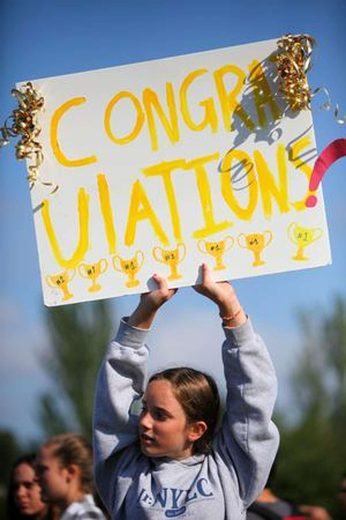 Sydney Horton, 12, looks for her mom Julie near the finish line.