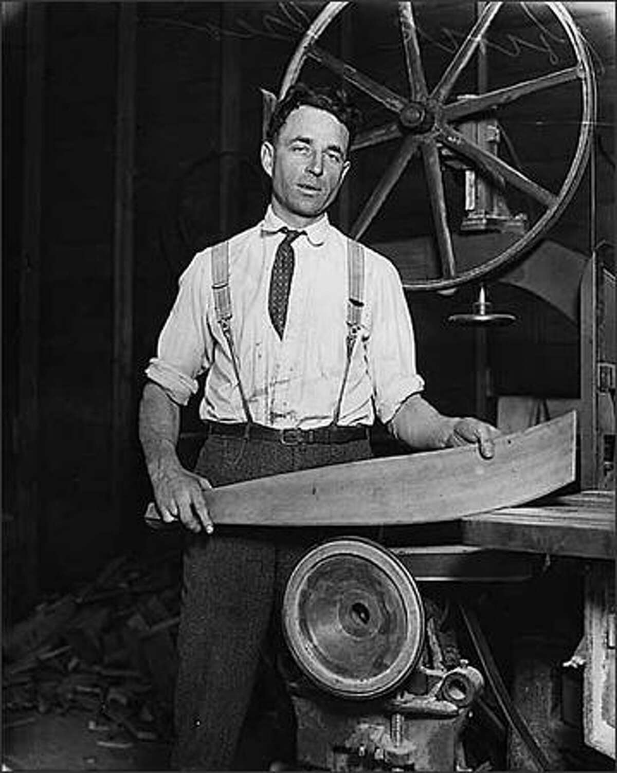George Pocock, rowing shell builder, Seattle, ca. 1928. Pocock and his brother Dick came to America after finishing apprenticeships building boats and racing sculls on the River Thames in England. While possessing no education beyond age 14, George embraced all aspects of collegiate rowing and was instrumental in the foundation of the University of Washington's early rowing years. Considered a master boat-builder, he implemented design innovations which greatly improved his boats' performance over his competitors. Possessing a deep appreciation for the art and beauty of rowing, he continued boat-building for 50 years, providing shells for most racing colleges in the country and many overseas as well. (Seattle Post-Intelligencer Collection, Museum of History & Industry 1986.5G.2411)