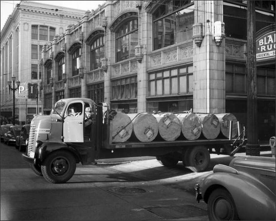 P-I truck driver John Waechter delivers newsprint to the P-I building, 1946. Photo: Museum Of History And Industry