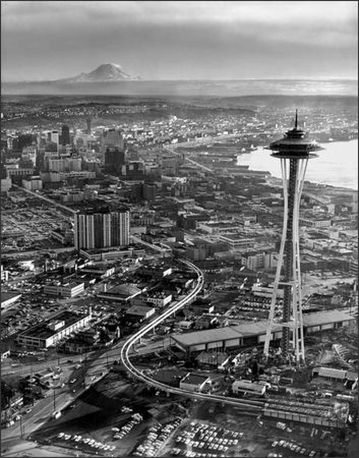 In January, 1962, construction was well underway for the Space Needle, monorail and other World's Fair projects as Mount Rainier watches over Seattle. (Seattle Post-Intelligencer photo)