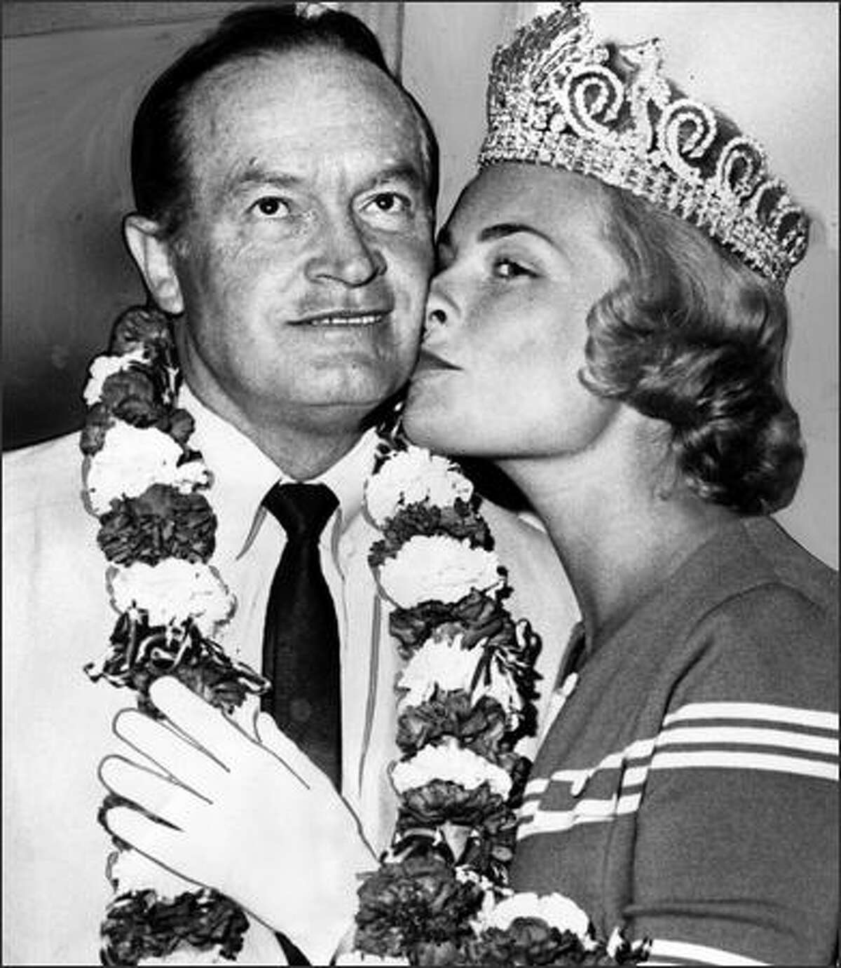 After the 1962 World's Fair put Seattle on the map, celebrities doing shows here often took part in Seafair. In 1963, Bob Hope was bussed by Seafair Queen Arlene Hinderlie and served as Honorary Grand Marshal for the Torchlight Parade. (P-I photo by Phil H. Webber)