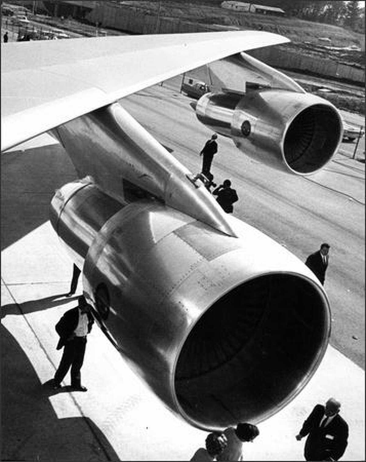 The wing of the first Boeing 747 is shown with onlookers underneath at the Boeing Everett plant on Sept. 30, 1968.