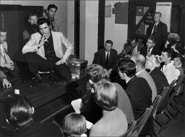 """Elvis Presley came to Seattle in 1962 to star in """"It Happened at the World's Fair."""" The P-I reported the New Washington Hotel was """"under siege by an army of starry-eyed teenage girls.'"""" National critics said the flick was forgettable, but the title said it all about the 1962 fair. Ten million people did come. (This picture of Presley was from his Sept. 1, 1957 visit to Sicks' Stadium in the Rainier Valley. (MOHAI/Seattle Post-Intelligencer Collection) Photo: Museum Of History And Industry"""