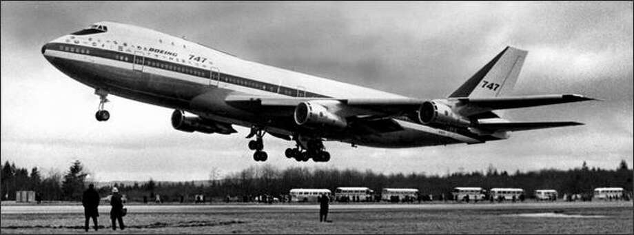 The first Boeing 747 first flew on Feb. 9, 1969. Seattle Post-Intelligencer photographer Phil Webber said editors at the time believed the plane was too big to fly, and insisted at a photographer be on hand for each of the first few test flights. The 747-100 was 231 feet, 4 inches long, with a 195-foot, 8-inch wingspan, and could carry 366 to 452 passengers up to 6,100 miles, cruising at 35,000 feet and 555 miles per hour. Photo: Museum Of History And Industry