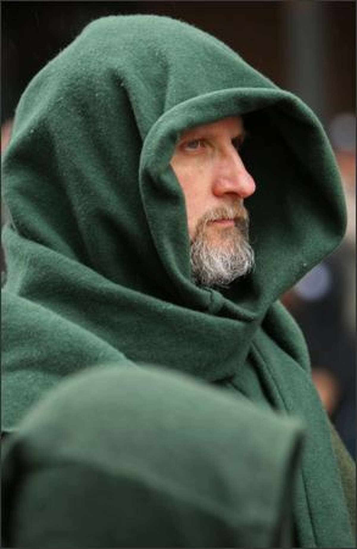 Scott West, wearing a 14th century cape and hood, participates in Seattle's St. Patrick's Day parade.