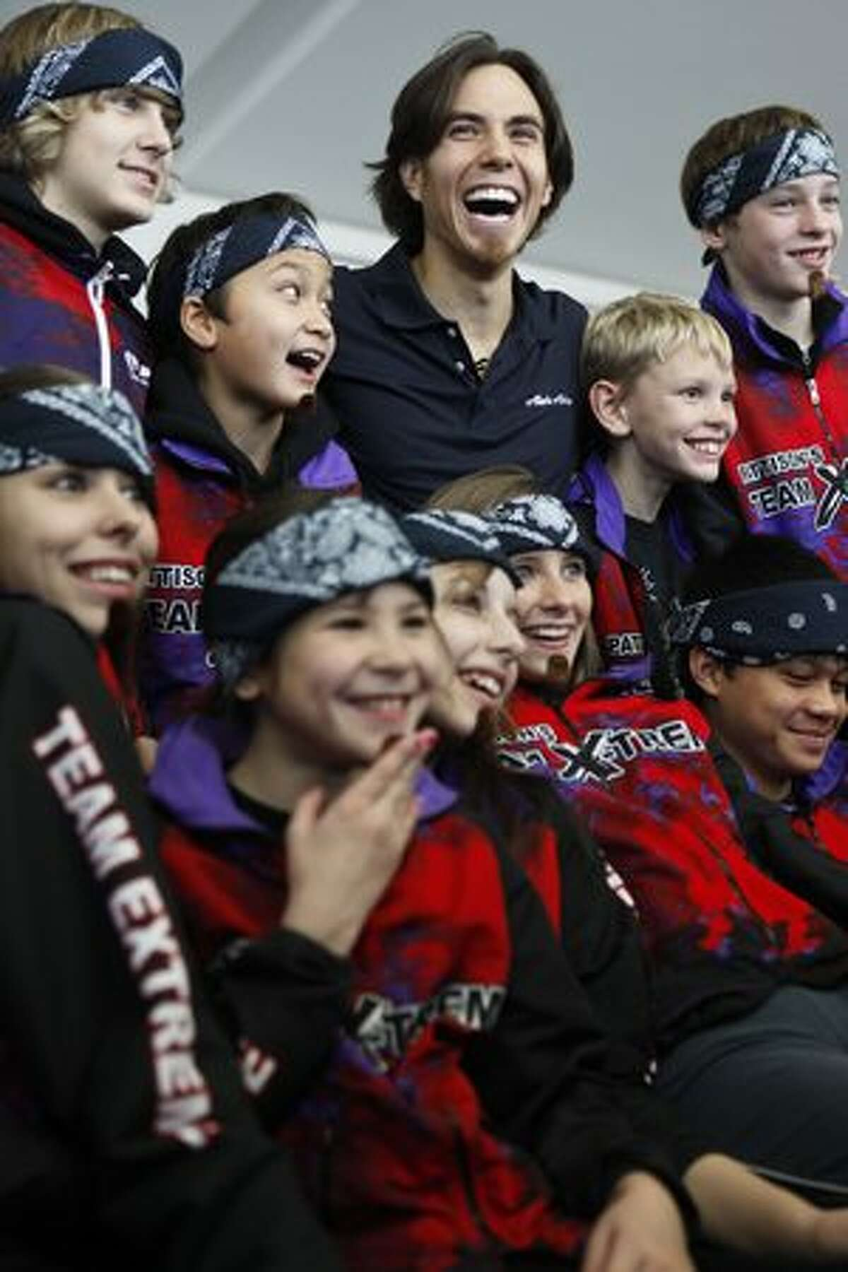 Members of Pattison's Team Extreme, a youth inline skating team that skates in Federal Way, pose with Apolo Ohno on Nov. 17, 2009.