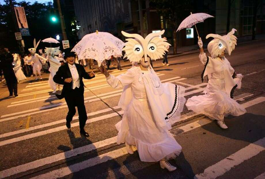Performers in Lullaby Moon, a show celebrating the new moon, dance through downtown Seattle on Thursday. Photo: Joshua Trujillo, Seattlepi.com