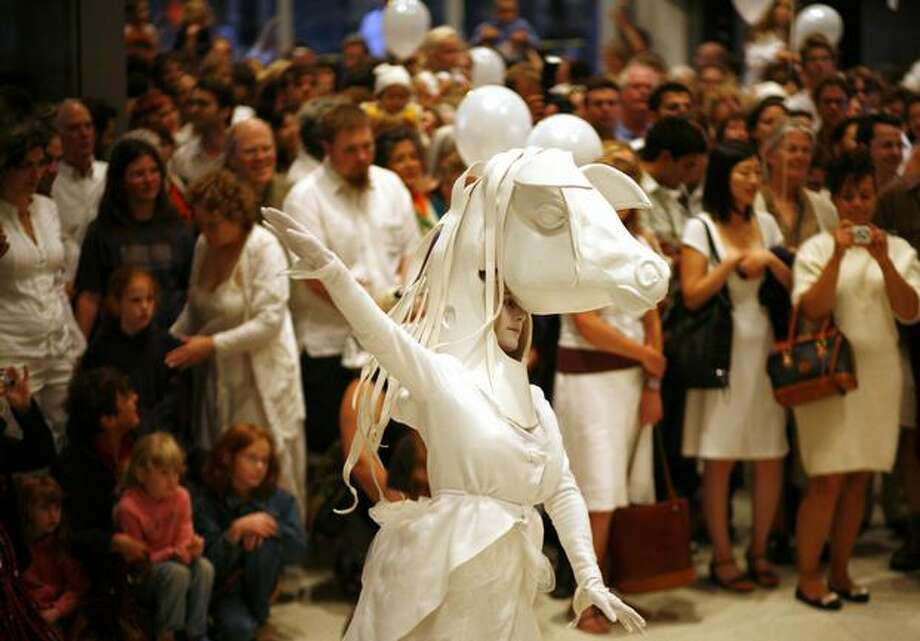 Performers in Lullaby Moon dance inside the Seattle Art Museum on Thursday. Photo: Joshua Trujillo, Seattlepi.com